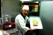 Excited japanese chef holding up a tray of food(1-18-08.com)